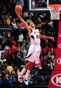 Thabo Sefolosha (25) of the Atlanta Hawks grabs a rebound against the Denver NuggetsPhoto credit: Scott Cunningham/NBAE via Getty Images